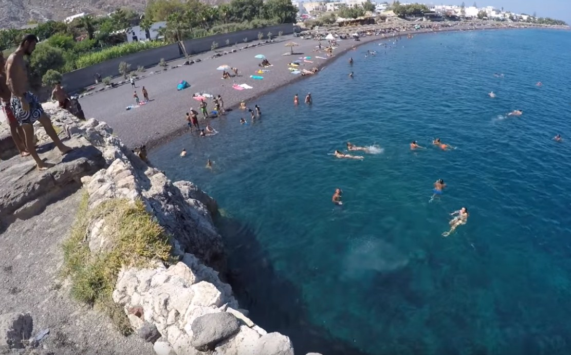 Kamari Beach in Santorini Island Cliff Diving